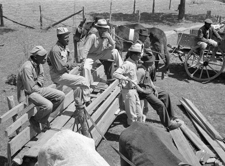 Group of FSA (Farm Security Administration) clients listening to speaker on project near Marshall, Texas. Sabine Farms, Texas - Photo: Russell Lee