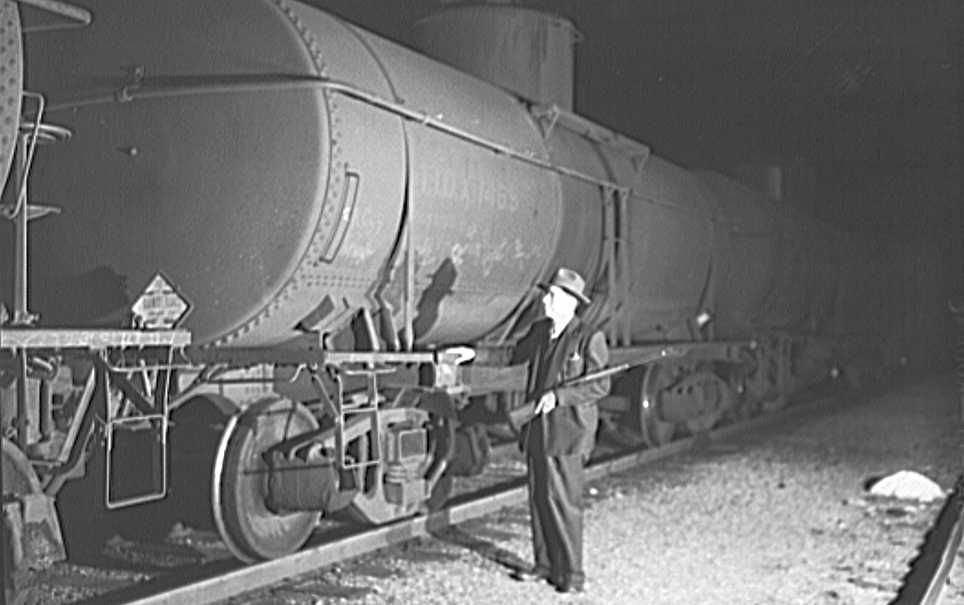 Railroad guard in Tulsa., Oklahoma yards  Photo: John Vachon, FSA/Library of Congress