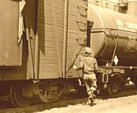 Boxcar kid running to catch freight from Library of Congress collection